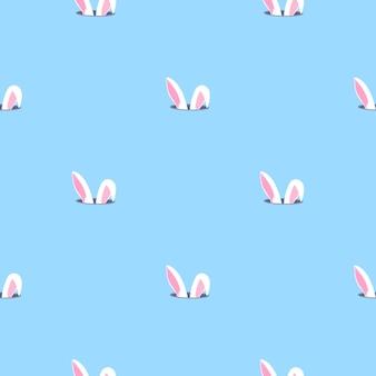 Hasenohren schaut aus dem loch. nahtloses muster des kaninchenkindes. kann für die dekoration des kinderzimmers, kinderkleidung, kinderaccessoires, geschenkverpackungen, digitales papier verwendet werden.