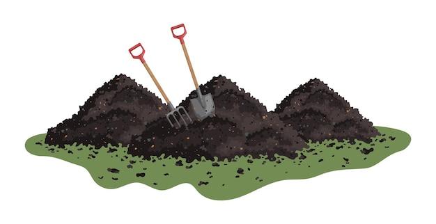 Haufen erde heugabel und schaufel in einem haufen boden haufen substrat humus dünger kompost
