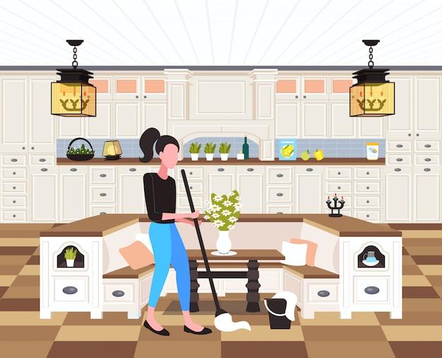 Hausfrau wischt boden frau reiniger mit mop reinigungsservice hausarbeit konzept moderne küche interieur in voller länge horizontal