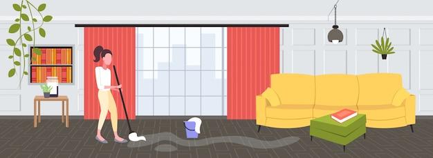 Hausfrau wischt boden frau reiniger mit mop reinigungsservice hausarbeit konzept modernen wohnzimmer innenraum in voller länge horizontal