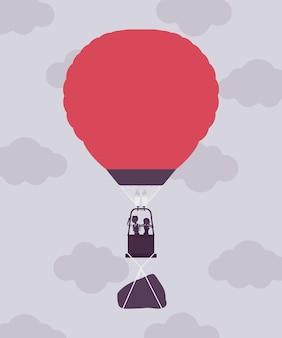 Heißluftballon mit geschäftsleuten im flug und einem felsen