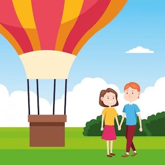 Heißluftballon und glückliches paar