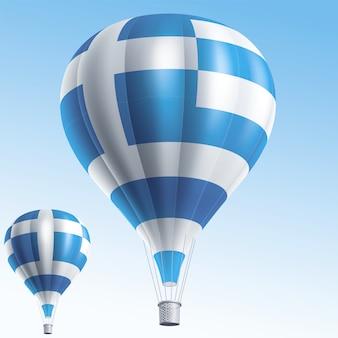 Heißluftballons gemalt als griechenland-flagge