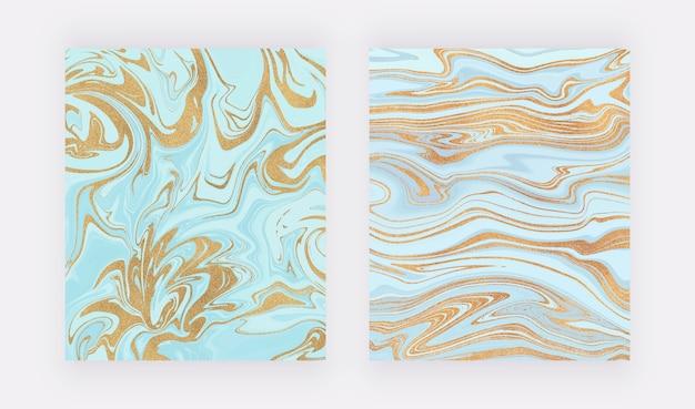 Hellblau mit goldglitzertintenmalerei. abstrakte flüssige aquarellbeschaffenheit.