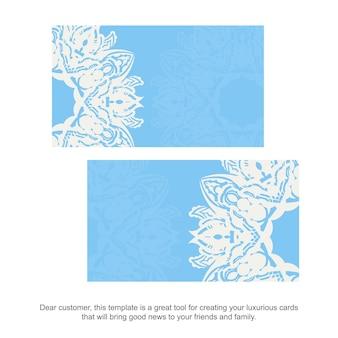 Hellblaue visitenkarte mit vintager weißer verzierung für ihr geschäft.