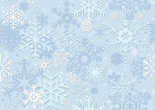 Hellblaues weihnachtspapier oder hintergrund mit schneeflocken