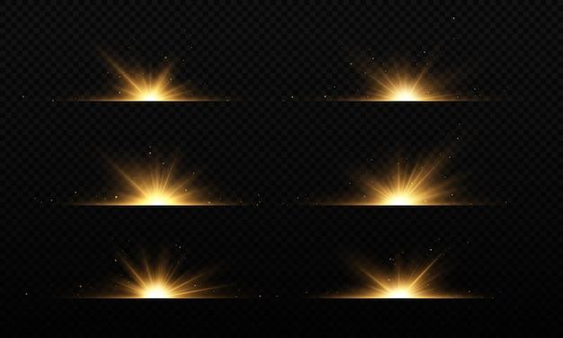 Helle goldene blitze auf schwarzem hintergrund leuchtende sterne schöne goldene strahlen optische flares