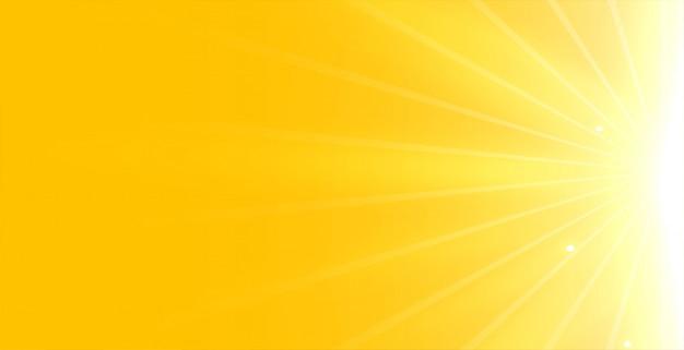 Heller gelber hintergrund mit leuchtendem strahlenlicht