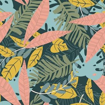 Helles abstraktes nahtloses muster mit bunten tropischen blättern und anlagen auf grün
