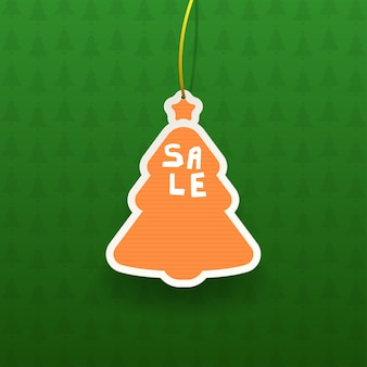 Helles buntes weihnachtsbaumverkaufsetikett mit realistischem schatten auf grünem strukturiertem hintergrund