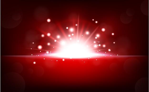 Helles rotes licht, das vom dunklen horizont steigt