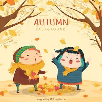 Herbst hintergrund mit niedlichen kindern