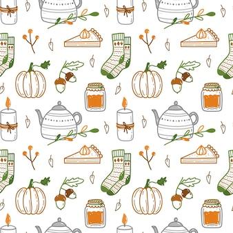 Herbst nahtlose muster mit kürbissen eicheln warme socken kerzen süße teekanne und andere