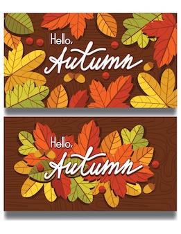Herbstblätter und beeren fallen über hölzernen texturhintergrund herunter. vorlage mit schriftzug zum drucken auf postkarten und flyern.