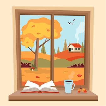 Herbstfenster mit ländlicher ansicht, einem buch und einer kaffeetasse auf der schwelle.