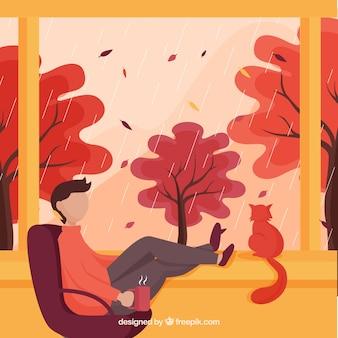 Herbsthintergrund mit dem entspannenden mann
