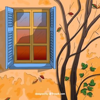 Herbsthintergrund mit fenster und niederlassungen