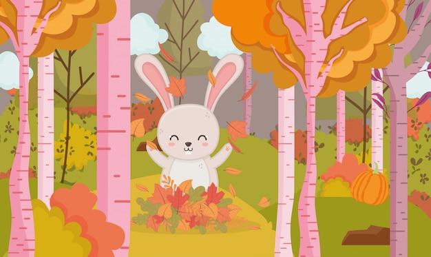 Herbstillustration des netten kaninchens spielend mit blattwald