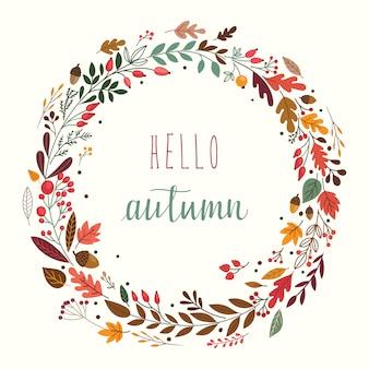 Herbstkranz mit blättern, pflanzen und dekorativen zweigen