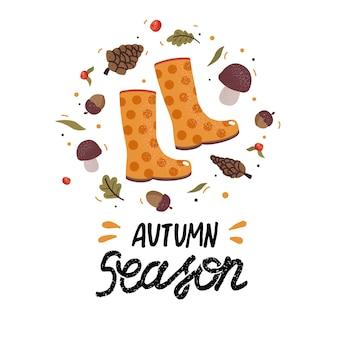 Herbstkranz mit gummistiefeln, fallenden blättern, eicheln, beeren, pilzen und schriftzug. sammelalbum sammlung von herbstsaison elementen. herbstgrußkarte