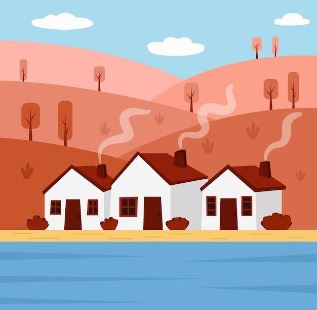 Herbstlandschaft mit hügeln und häusern am flussufer