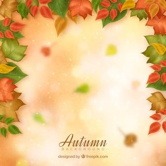 Herbstlaub zerstreut auf helle oberfläche