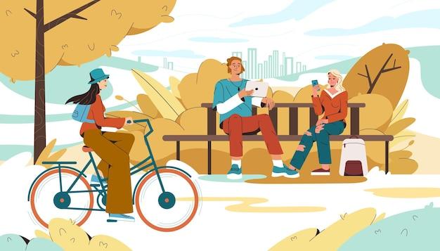 Herbstlicher stadtpark mit leuten, die gadgest verwenden und mädchen radfahren