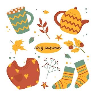 Herbstlicher wohnkomfort. eine reihe von haushaltsgegenständen wie cappuccino, wasserkocher, pullover, socken. handzeichnung. cartoon-stil. isoliert auf weißem hintergrund.