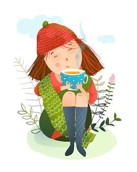 Herbstmädchen und warme tasse tee