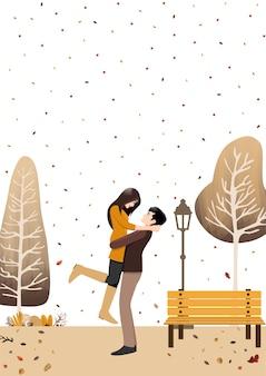 Herbstpaar, das im herbstgartenhintergrund steht