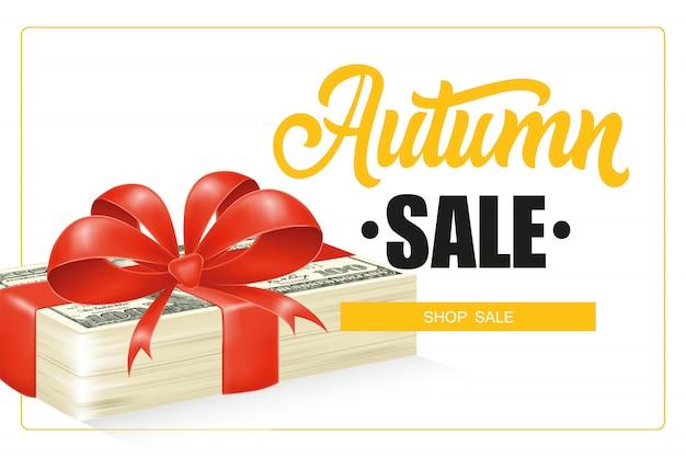 Herbstverkaufsbeschriftung im rahmen- und dollarscheinstapel mit bogen