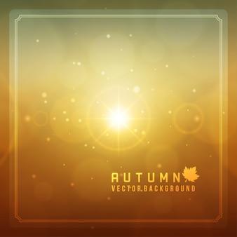 Herbstzusammenfassung unscharfes bokeh und helles blendenfleckhintergrund der sonne.