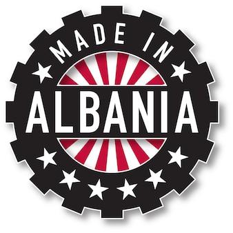 Hergestellt in albanien flaggenfarbstempel. vektor-illustration