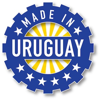 Hergestellt in uruguay-flaggenfarbstempel. vektor-illustration