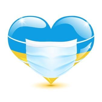 Herz in den farben der ukrainischen flagge mit einer medizinischen maske zum schutz vor coronavirus
