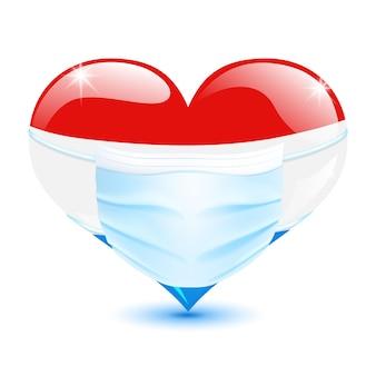 Herz in den niederländischen flaggenfarben mit einer medizinischen maske zum schutz vor coronavirus