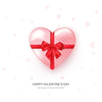 Herzförmige geschenkbox mit roter seidenschleife. valentinstag gruß vorlage.