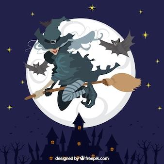 Hexe fliegt auf besen mit fledermäusen