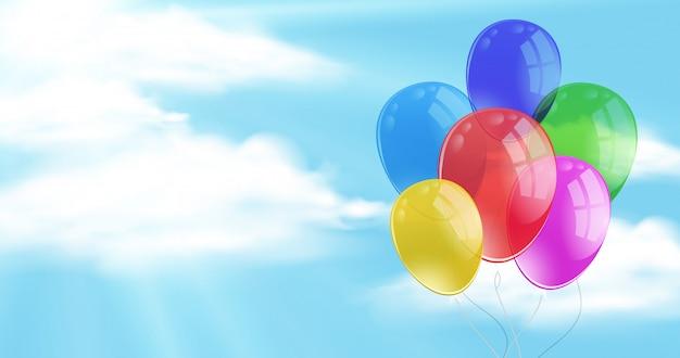 Himmelhintergrund mit den balloons, die in einer luft schwimmen