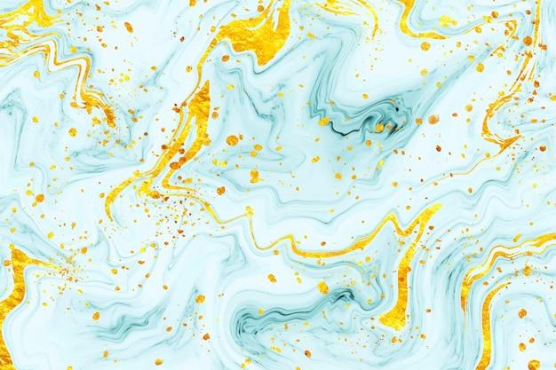 Hintergrund aus flüssigem marmor mit goldspritzer
