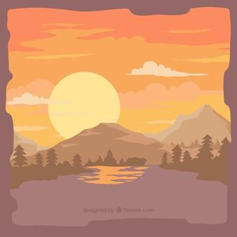 Hintergrund der bäume und berge bei sonnenuntergang