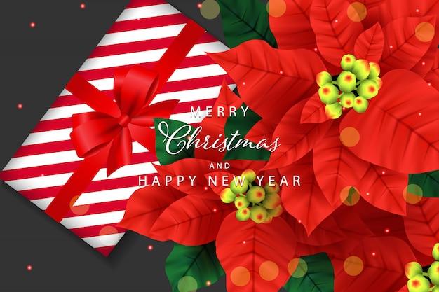 Hintergrund der frohen weihnachten mit weihnachtsstern und geschenkbox Premium Vektoren