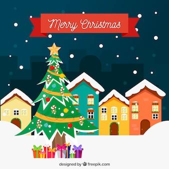 Hintergrund der geschneiten häuser und weihnachtsbaum