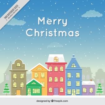 Hintergrund der schönen verschneite häuser-fassaden merry christmas