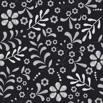 Hintergrund der Stickerei mit Blumen
