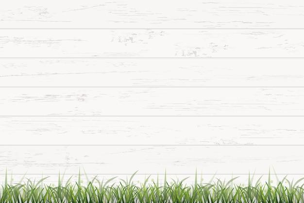 Hintergrund des grünen grases und des holzes.