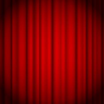 Hintergrund des roten vorhangs beleuchtet durch einen strahl des scheinwerfers.