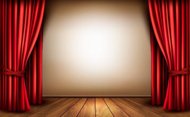 Hintergrund mit rotem samtvorhang und einem holzboden.