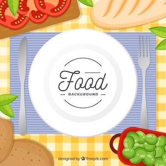 Hintergrund mit teller und essen in der draufsicht