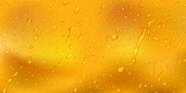 Hintergrund mit tropfen und wasserstreifen in gelben farben, die die oberfläche hinunterfließen